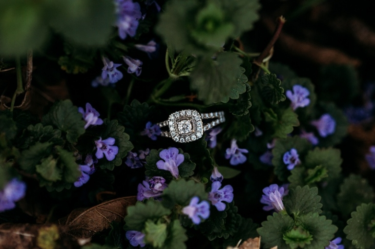 diamond engagement ring in purple flowers